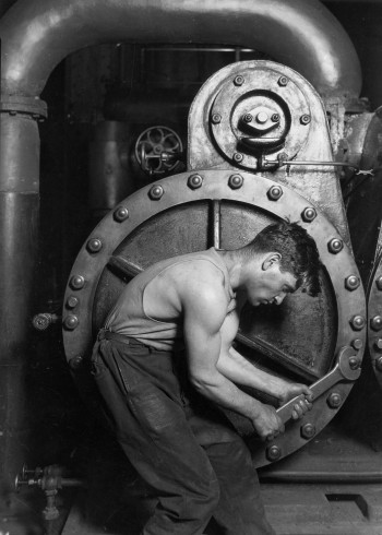 Lewis_Hine_Power_house_mechanic_working_on_steam_pump-350x490.jpg