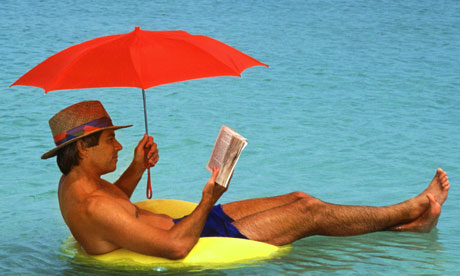 reading in the water with umbrella.jpg