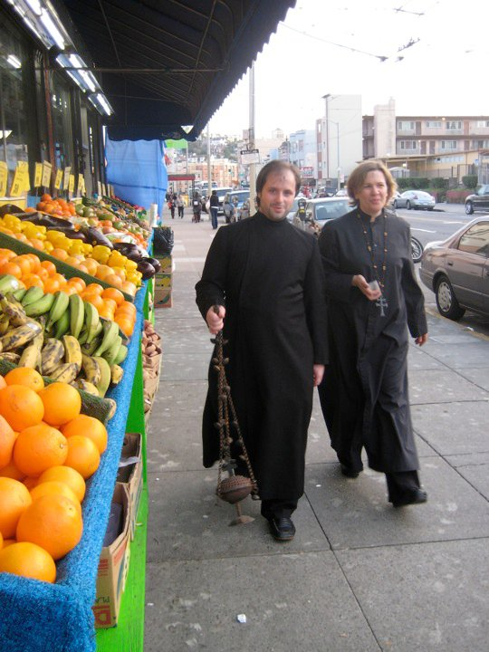 sarah and friend in cassocks.jpg